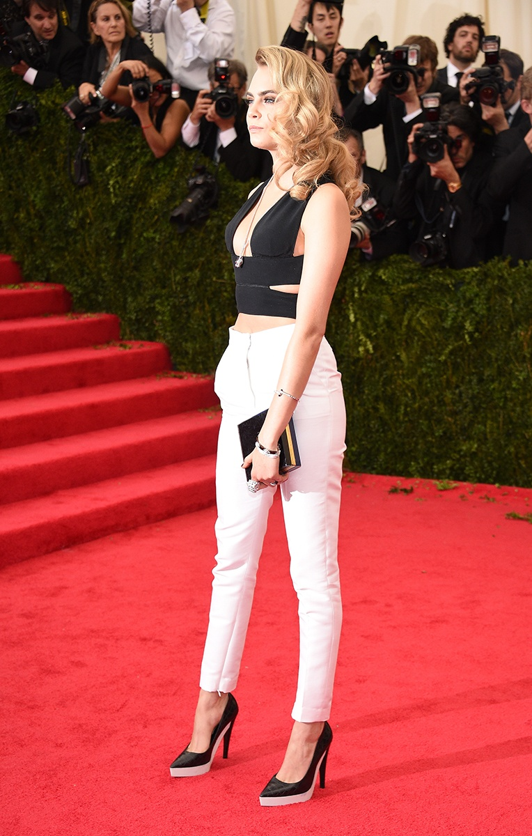 Cara Delevingne in a Stella McCartney top, pants, and shoes, and Cartier jewelry