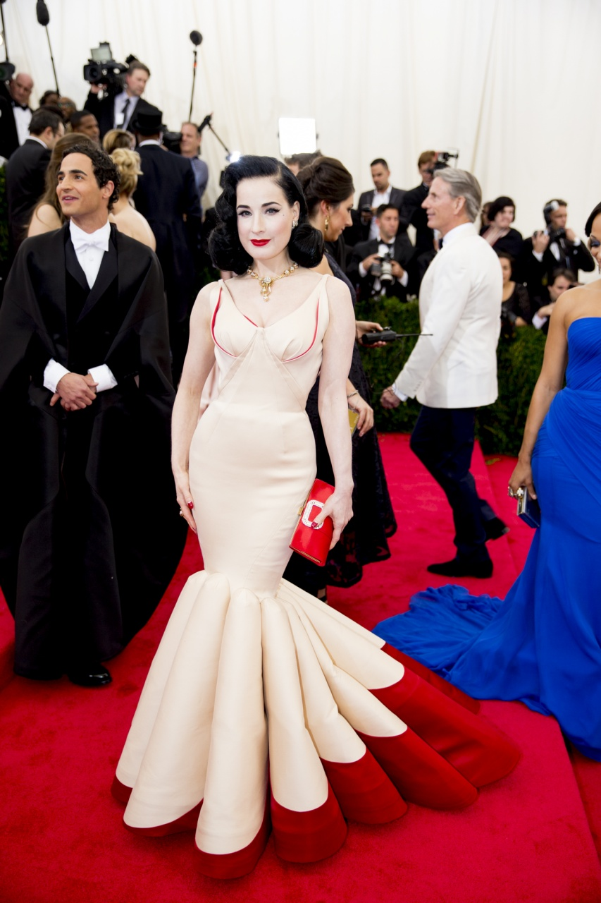 Dita Von Teese in a Zac Posen dress, Van Cleef & Arpels jewelry, and Roger Vivier bag