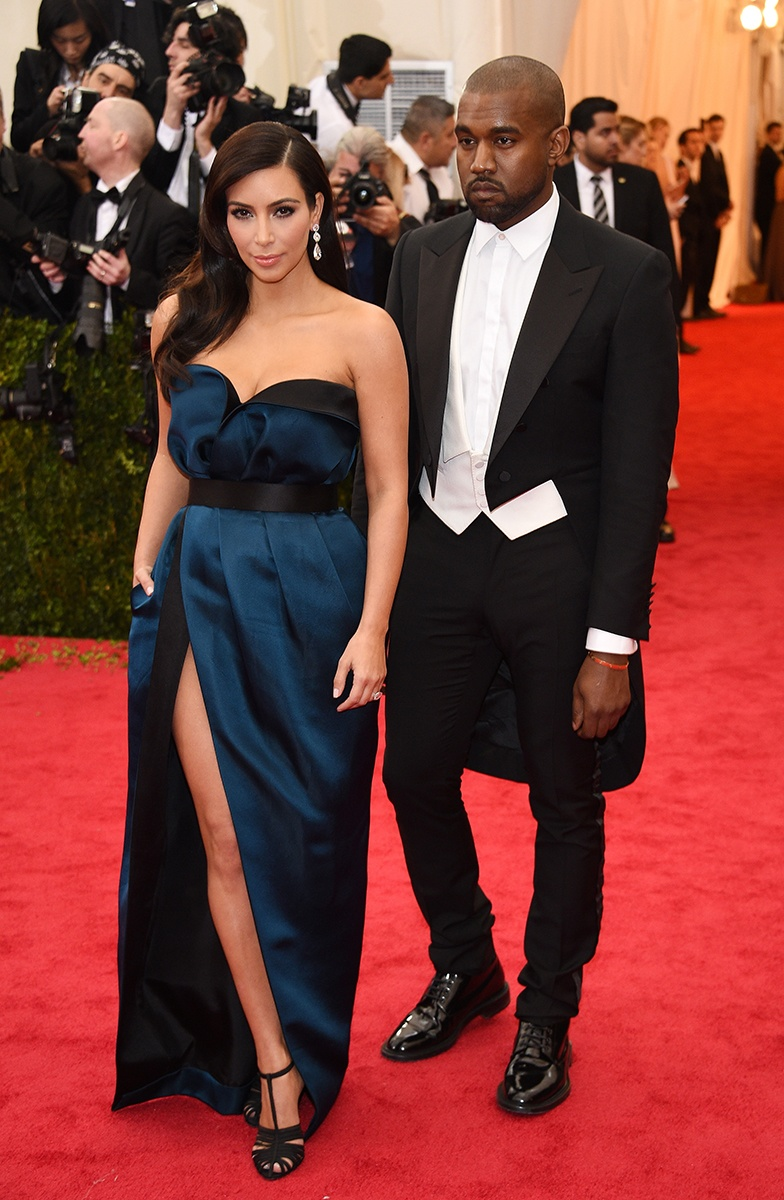 Kim Kardashian in a Lanvin dress and Lorraine Schwartz jewelry and Kanye West in Lanvin